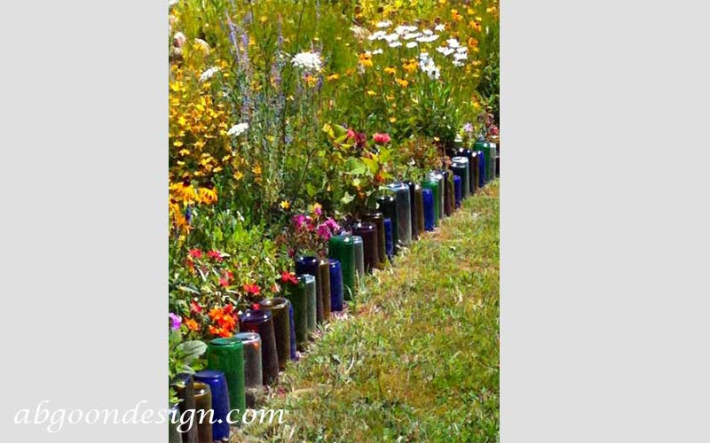 ایجاد حاشیه باغچه با بطری های شیشه ای